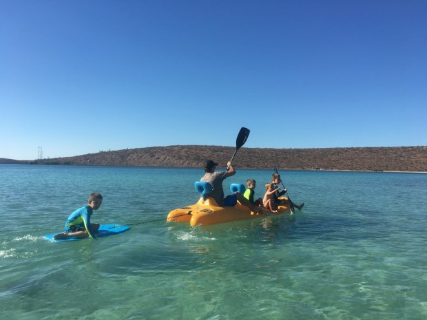 Sully didn't want to go in the water until he saw these boys playing on this kayak. Then he stripped down to his undies and jumped on. After the boys played, their dad offered to give Sully a ride all the way back to Astraea.