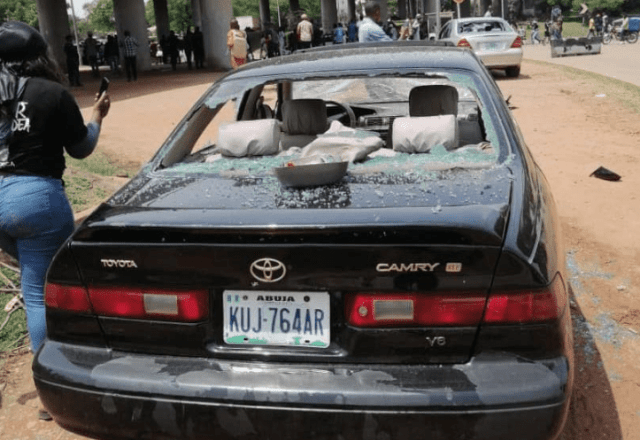 Abuja Protest: Cars vandalised by thugs