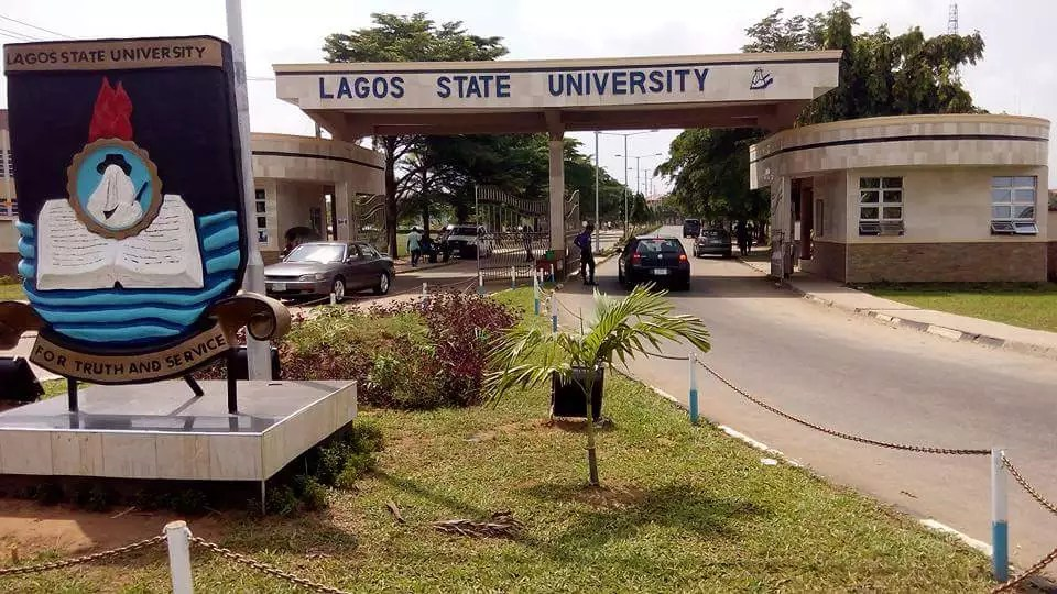 Lagos State University entrance and emblem