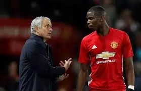 football coach giving instructions to player