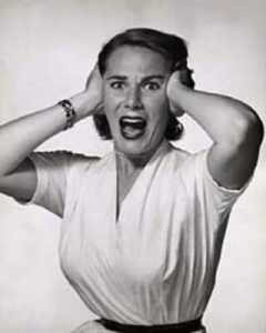 Black and white photo of woman with scared face.