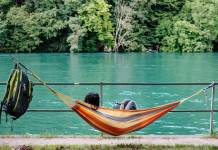 Publisher lying in hammock reading an ebook