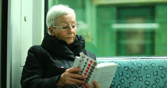 Woman reading on a train