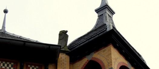 Carved stone bird on roof of Centraal Apotheek Leeuwarden