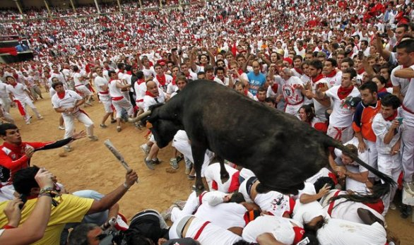 Photo by: Ivan Aguinaga ** FILE ** A bull jumps over revelers July 8, 2012, in a bullring during the second running of the bulls at the San Fermin fiestas in Pamplona, Spain. (Associated Press)