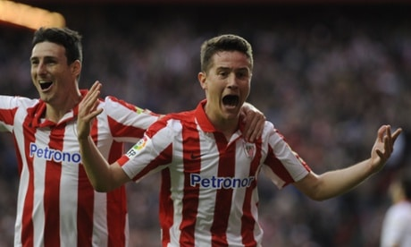 Athletic Bilbao's midfielder Ander Herrera (R) celebrates with Athletic Bilbao's forward Aritz Aduriz (L). Photograph: RAFA RIVAS/AFP/Getty Images