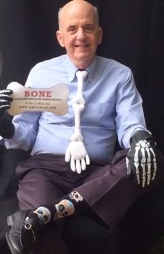 Roy with AB card and bone regalia 4 18 ii