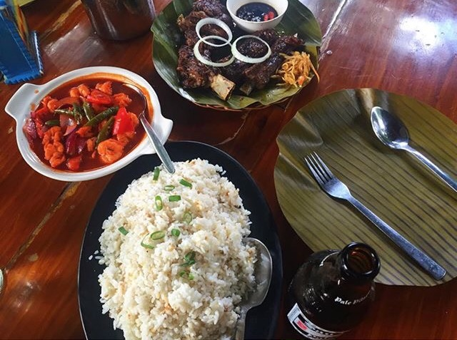 Filipino meal with rice, ulam, spoon, and fork.