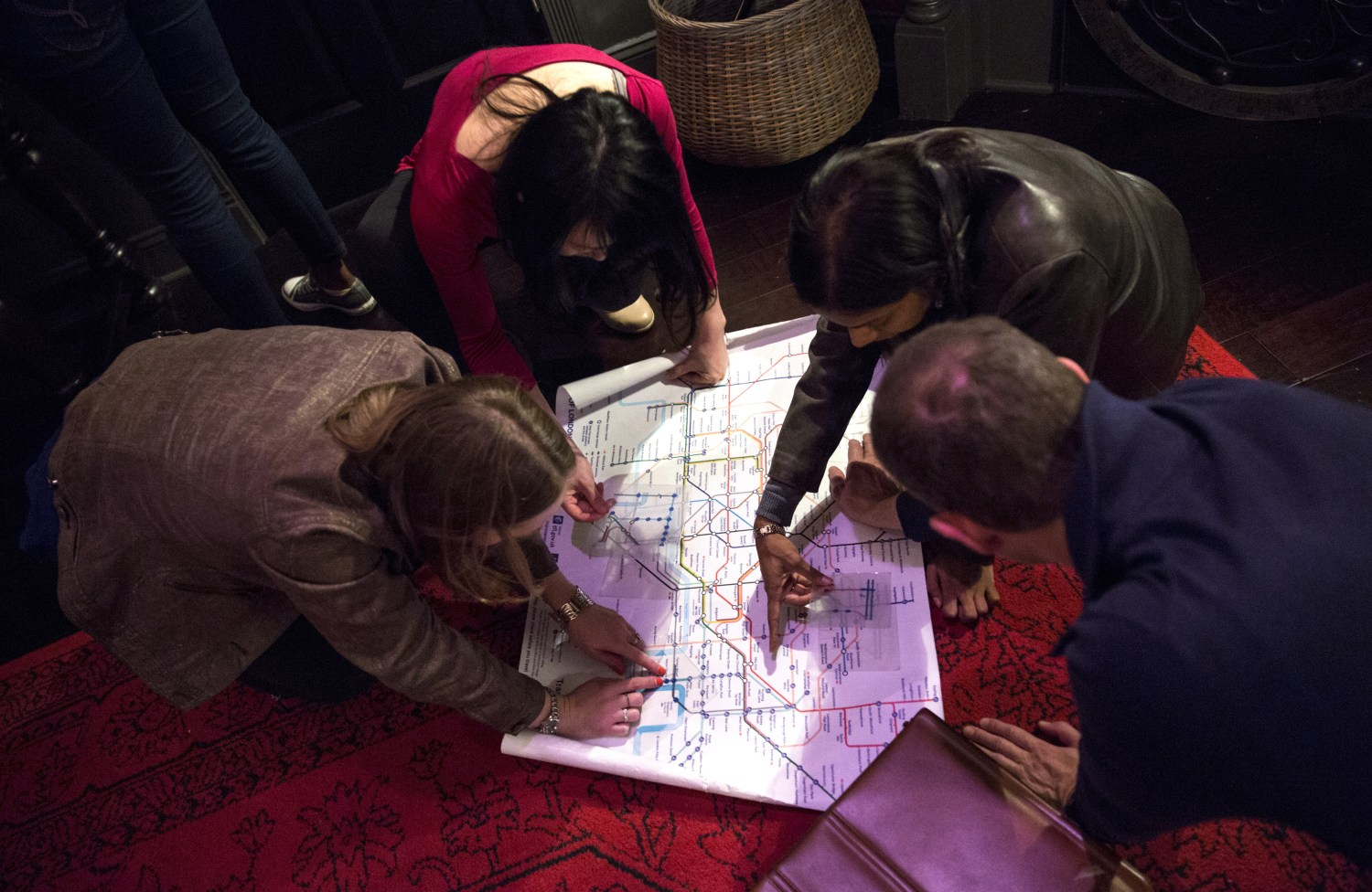 A team works together to gather hints to escape a room in Haifax, Nova Scotia.