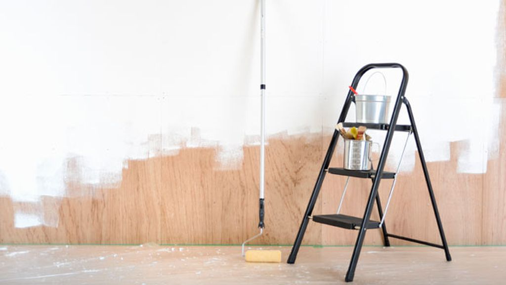 A half-painted wall along with a step ladder