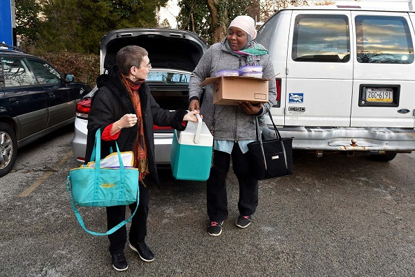 Sandy Choukroun (left) and Fatmata Sillah (right) with the Sisterhood of Salaam Shalom, deliver frozen kosher and halal meals at the Philadelphia Interfaith Hospitality Network in Mt. Airy February 15, 2017. For religious families who are hungry, it can be especially hard to find help in the form of healthy meals. The sisterhood brings together Jewish and Muslim women to cultivate community and understanding. TOM GRALISH / Staff Photographer