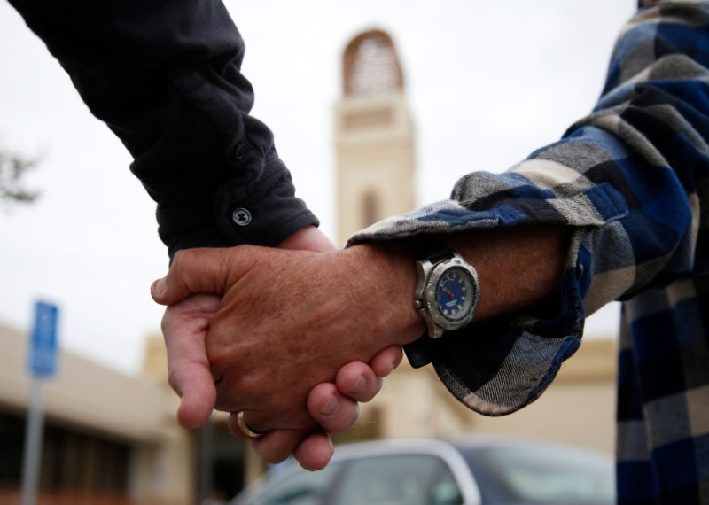 """Participants hold hands for """"Hands Around the Mosque"""" outside the Muslim Community Association in Santa Clara, Calif. on Sunday, March 19, 2017. (Nhat V. Meyer/Bay Area News Group)"""