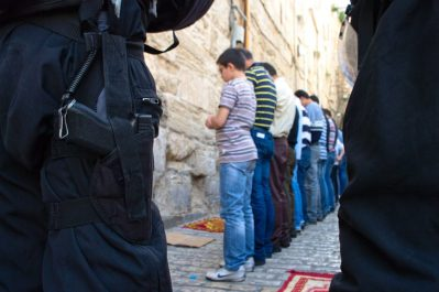 Muslims praying outsite al aqsa mosque
