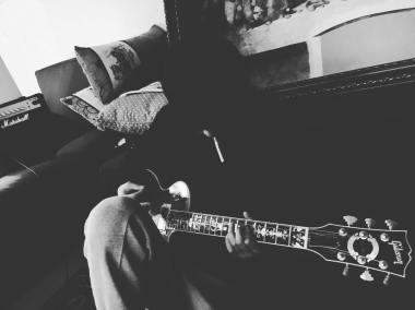 Jung Joon Young with guitar and cigarette at home