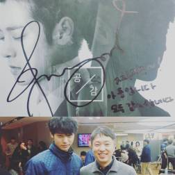 Jung Joon Young with former CEO of CJ E&M Ahn Seok Joon