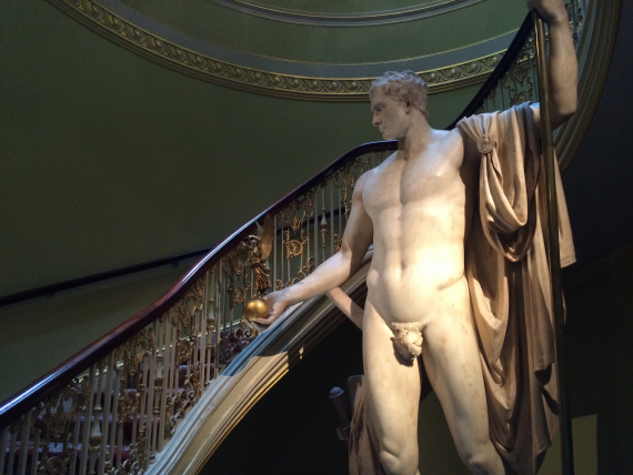 A larger than life-size statue of Napoleon in the stairwell.