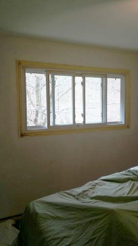 A boys bedroom without paint or trim, before it was turned into a hockey bedroom by AboutMurals.ca