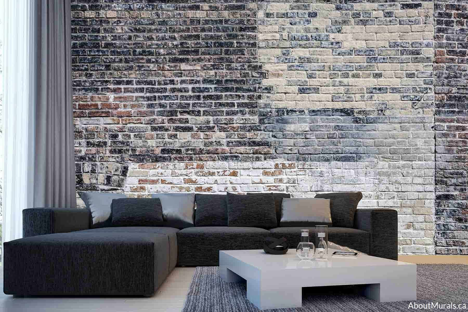 Old Multi Colored Brick Wall Mural, as seen in this living room, features black and white decaying paint on industrial feeling brick. Brick wallpaper sold by AboutMurals.ca.