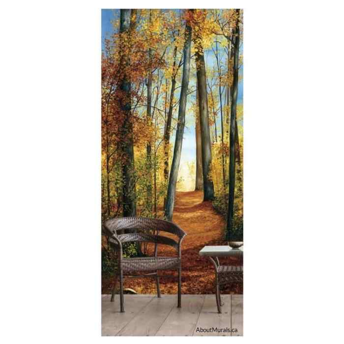 Path of Light wall mural, an autumn themed forest wallpaper, sits behind a wicker chair and table.
