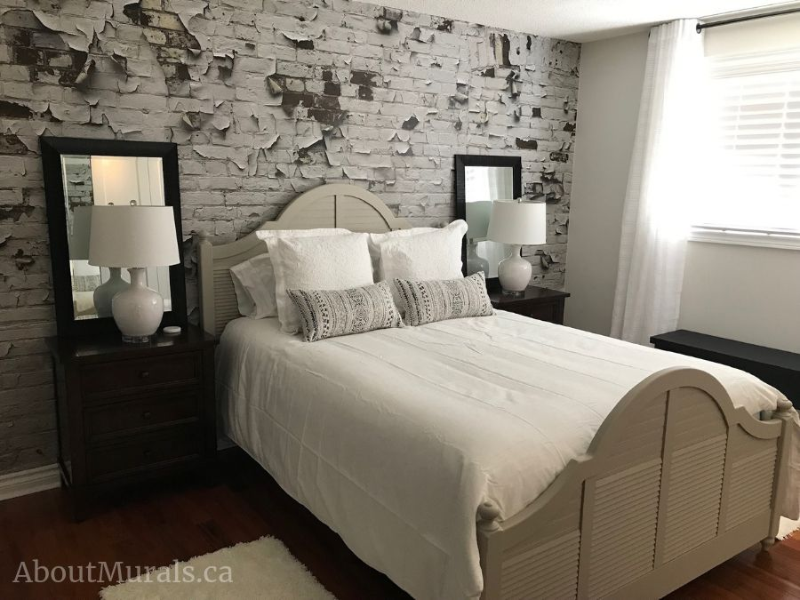 A faux brick wall mural in a white bedroom from AboutMurals.ca
