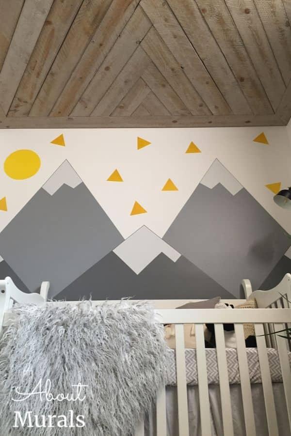 A DIY Mountain Mural over a crib
