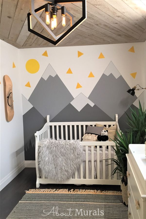 A grey mountain mural in a baby nursery painted by AboutMurals.ca
