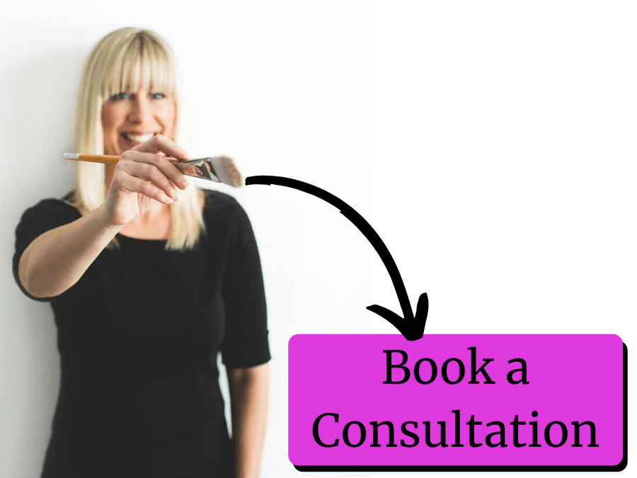 A woman paints an arrow pointing to a button reading Book a Consultation