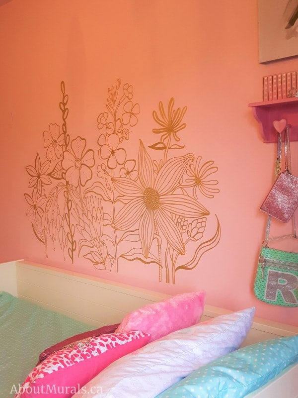 A wildflower mural painted by Adrienne of AboutMurals.ca in a shimmery gold paint