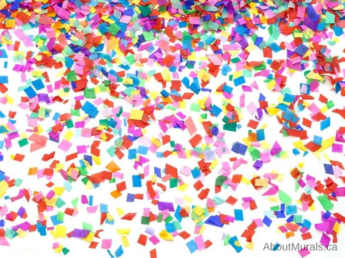 Confetti Wallpaper is an explosion of rainbow coloured tissue paper printed on removable wallpaper from AboutMurals.ca