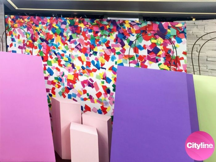A confetti wallpaper by AboutMurals.ca is on a Cityline set with gift bags ready for audience members