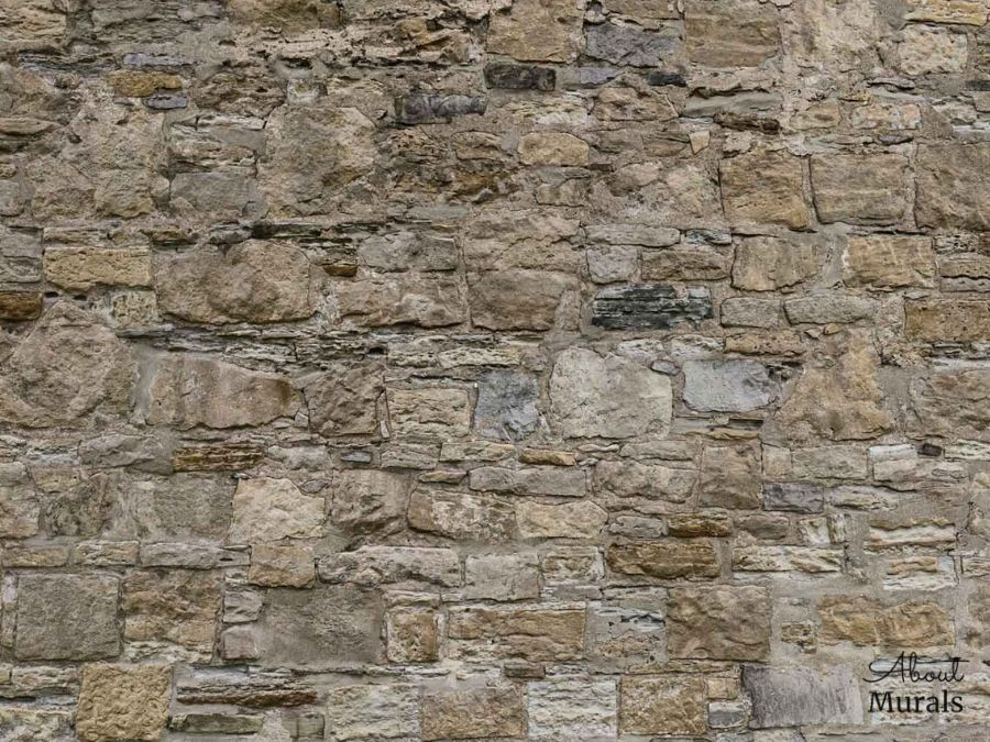 Castle Stone Wallpaper features a wall of rugged, textured brown stones. Stone wall murals from AboutMurals.ca.