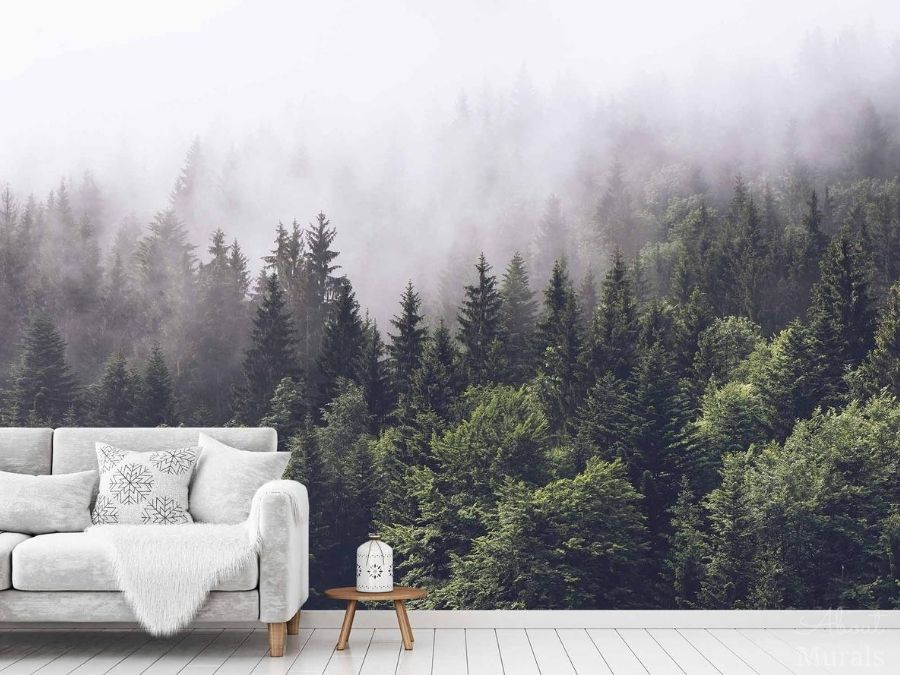 Foggy Forest Wallpaper, as seen on the wall of this living room, features a grey misty fog settling over dark pine trees. Pine tree wallpaper sold by AboutMurals.ca.