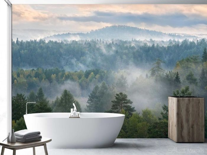 Misty Forest Wallpaper, as seen on the wall of this bathroom, features grey fog settling over dark pine trees in Deer Streams Park, Russia. Pine tree wallpaper sold by AboutMurals.ca.