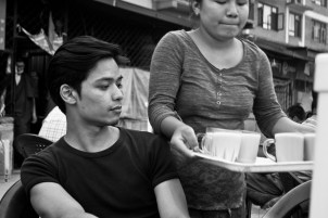 A girl serving Po Cha at Boudha, Kathmandu