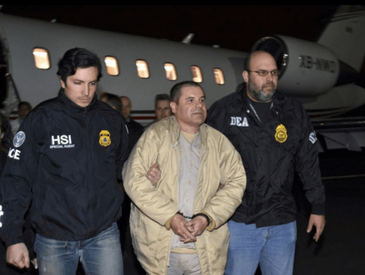 Joaquin 'El Chapo' Guzman being escorted by Federal authorities from a plane at Long Island's MacArthur Airport in 2017.