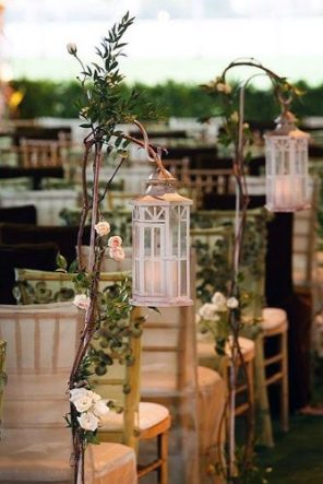 lantern-wedding-centerpiece-aisle-decorated-with-white-lanterns-suspended-on-wooden-branches-with-flowers-muse-books-via-instagram-334x500