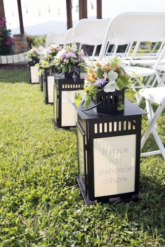 lantern-wedding-centerpiece-pass-adorn-lights-with-the-inscription-and-flowers-brent-gulledge-photography-334x500