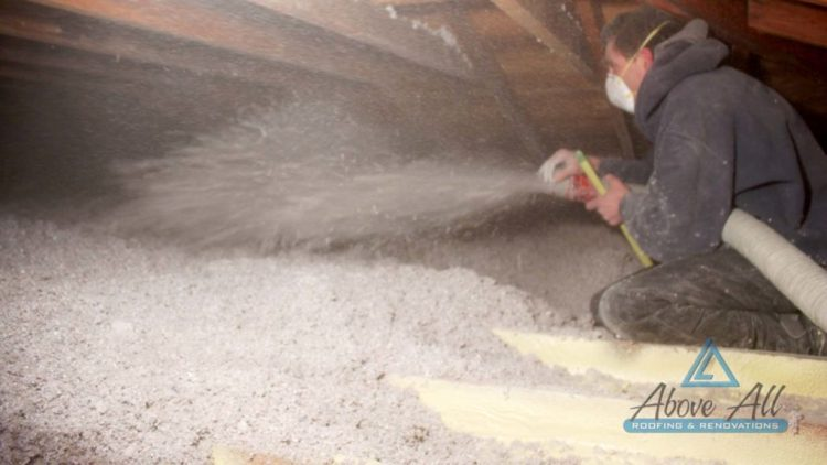 Cellulose Insulation being blown into attic to R-50.