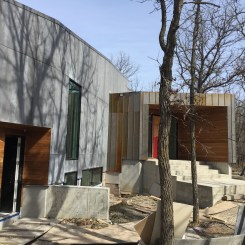 Metal, concrete, and wood siding provide an inspiring exterior to this Winnipeg home