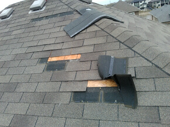 repair roof shingles that are blown off