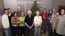 My extended family holding their BoGo lights in front of the Christmas tree