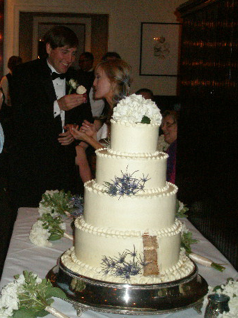 Bride and groom share cake