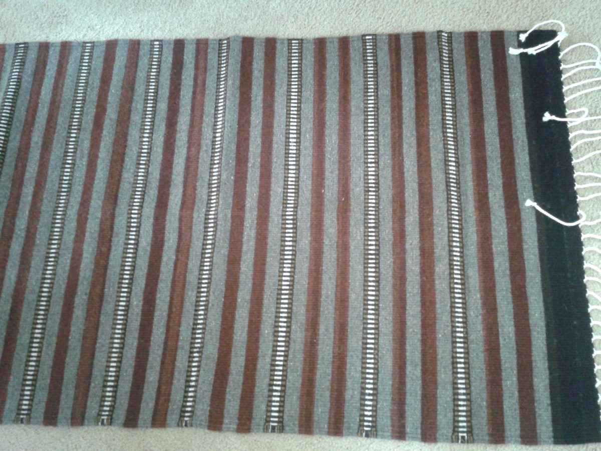 A striped rug in natural colors
