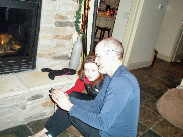 Julia and Tom sitting in front of the fireplace
