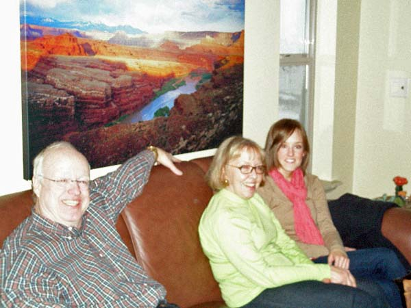 Craig, Mary Ann, and Emily sitting on the sofa
