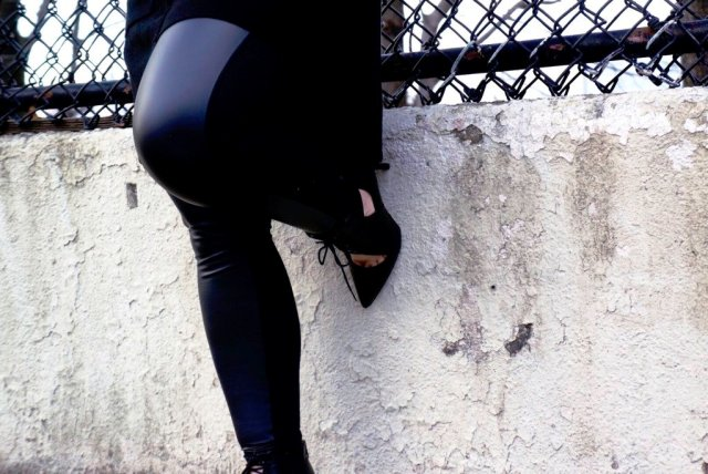 Pose against Fence