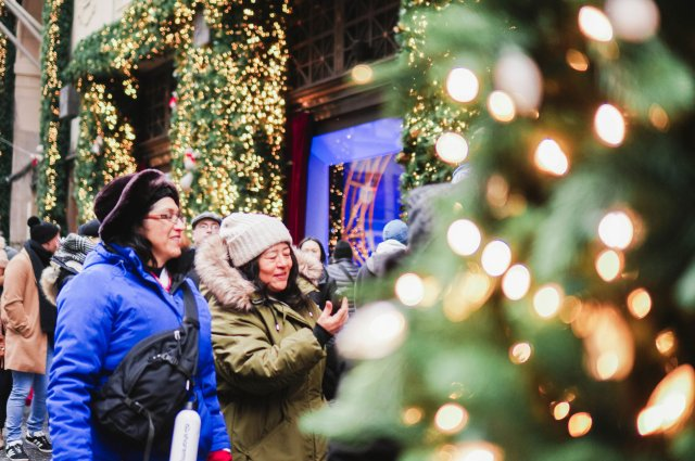 Women-walking-past-Xmas-tree