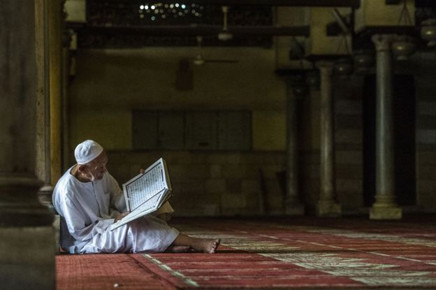 An elderly man reading the Koran at the al-Azhar mosque in Cairo