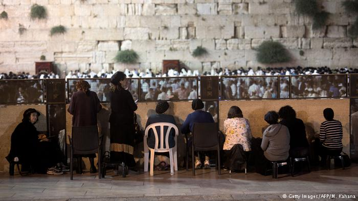 Women may only pray in a small area a ways away from the wall. Photo: Getty Images/AFP