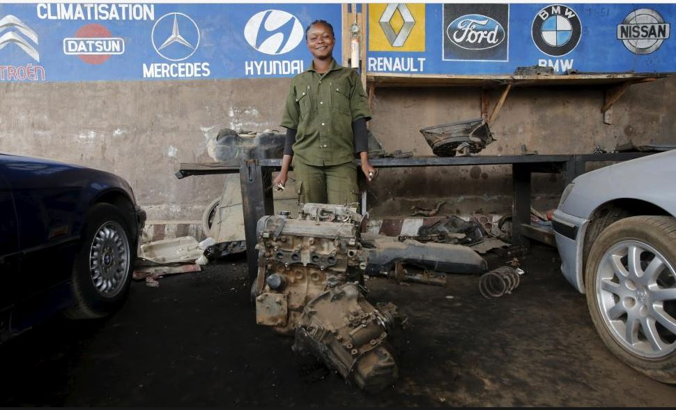 Marie Sassou, a 21-year-old car mechanic, poses for a photograph in the garage she works at in Bouake, Ivory Coast February 10, 2016. REUTERS/Thierry Gouegnon